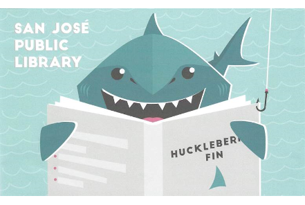 Library card design with cartoonish-looking shark gets hooked on reading Huckleberry Finn