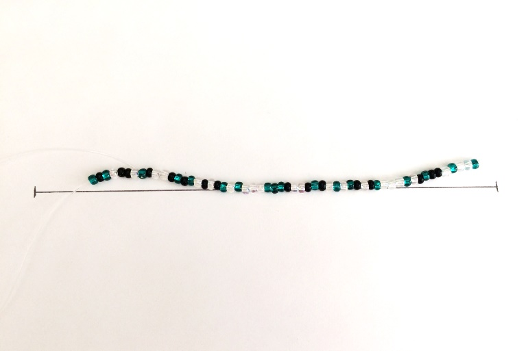 check the length of your beaded bracelet against your measured line