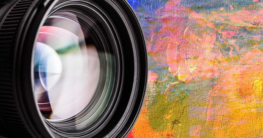 camera lens closeup with abstract art behind