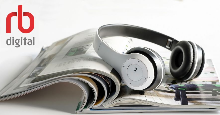 Headphones sit on a magazine