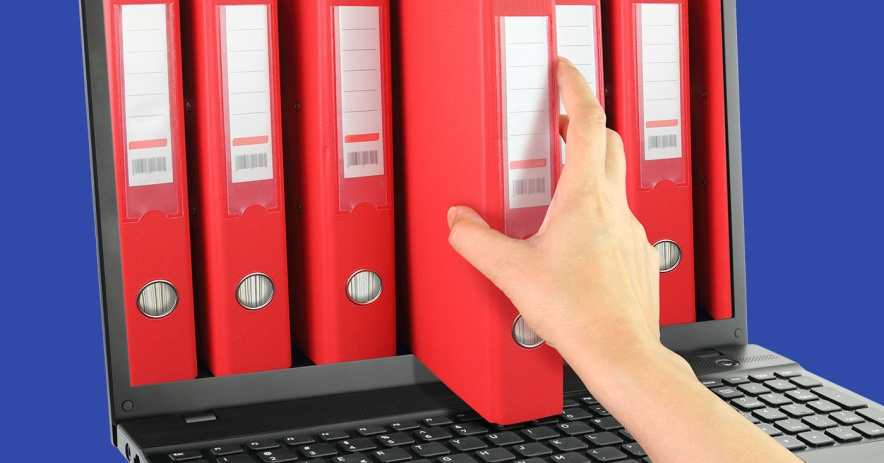 hand pulling binders out of laptop screen