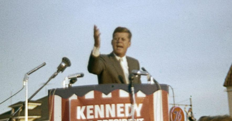 """We're going to tell the truth,"" Kennedy said, ""and I don't care what Mr. Nixon says, we're going to meet that responsibility."" Senator Kennedy was introduced by Mayor Paul Moore, with platform guests including local Democratic candidates Russell Bryan, Jack Kennon, and Al Alquist; City Councilmen Emery Delmas and Robert C. Doerr, and County Democratic Chairman John Thorne. Photo by Josephine Curto."