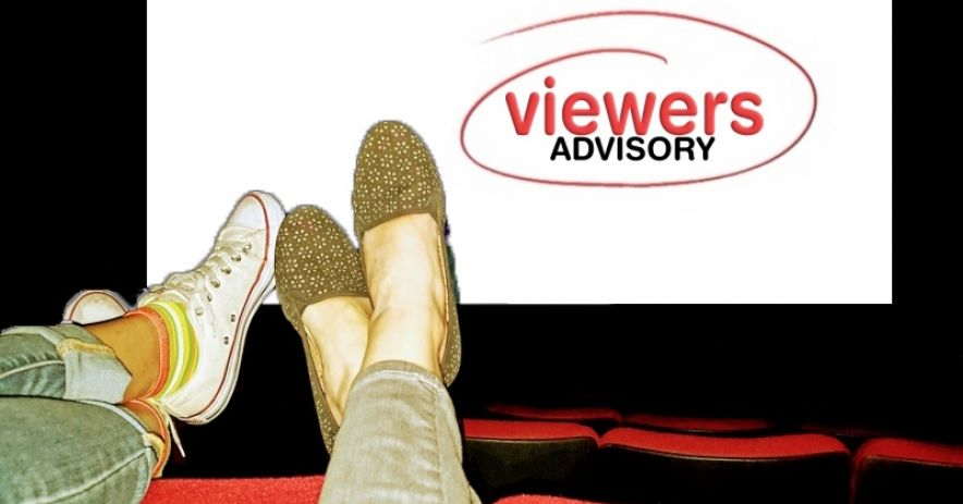 Viewer's Advisory - two pairs of feet atop movie theater seats