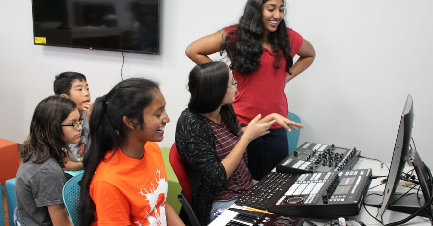 Teens happily tinker with the recording studio equipment at SJPL TeenHQ.