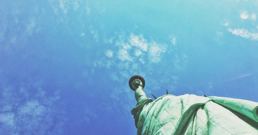 Statue of Liberty against a blue sky