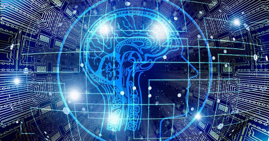 Blue, glowing circuit board illustration with blue circuits shaped to form an illustration of a of a human head and brain