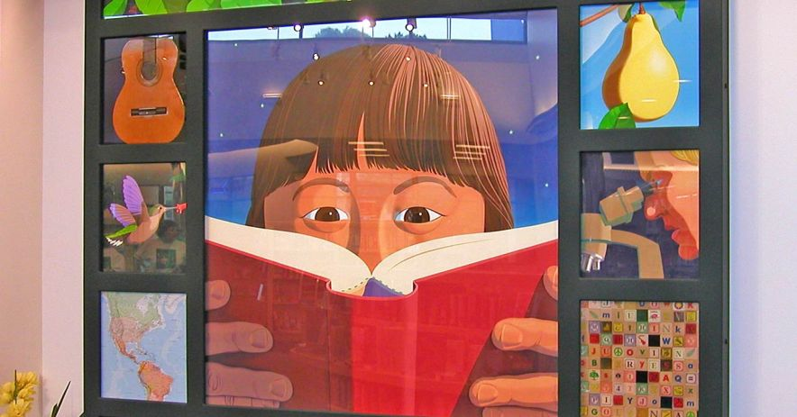 Berryessa children's area mural featuring a child with their 'nose in a book'