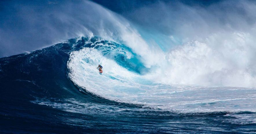 Surfer on a gigantic wave.
