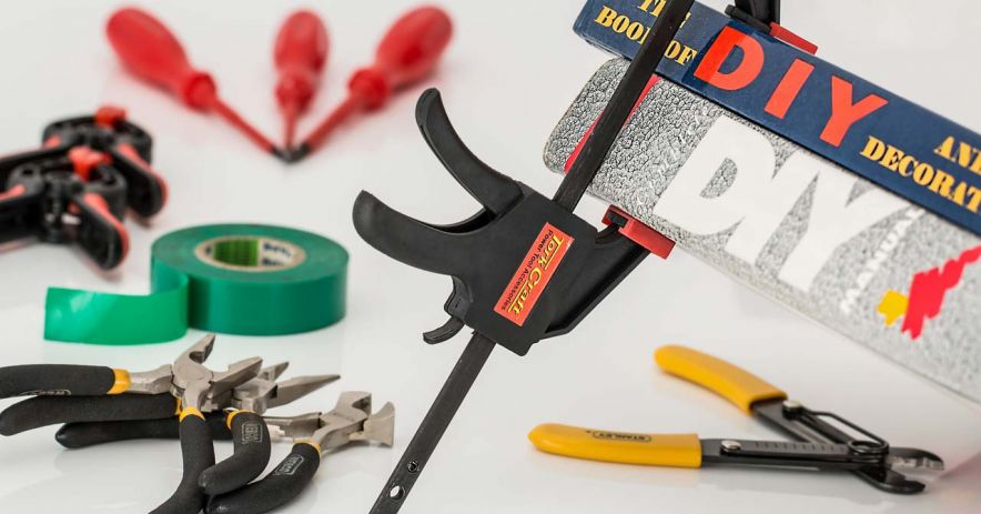 Do-it-yourself tools including pliers, screwdrivers, and tape.
