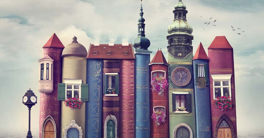 Books forming into a whimsical fantasy building.