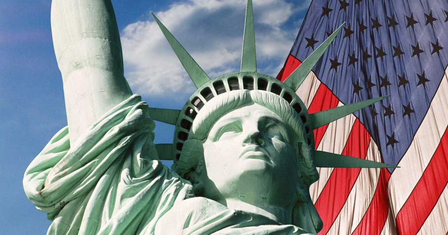 Statue of Liberty with American flag.