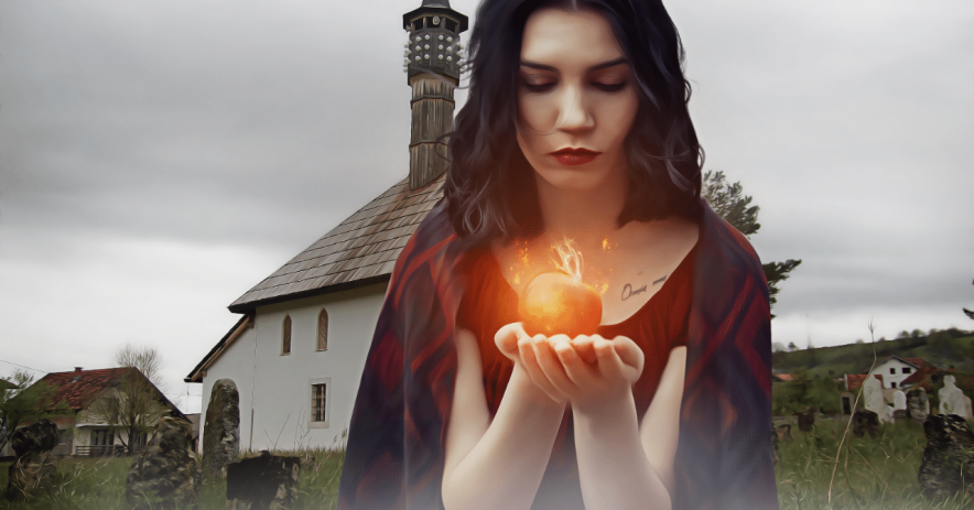 Woman standing in front of farmhouse holding a glowing apple