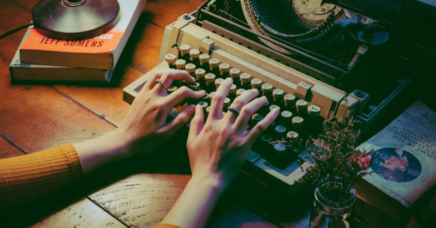 Hands typing at a typewriter