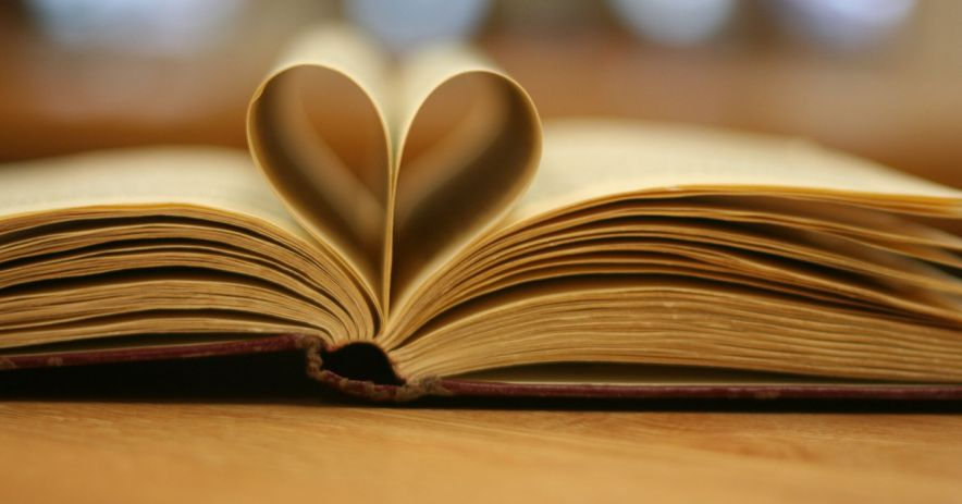 Book with pages folded in the shape of a heart.