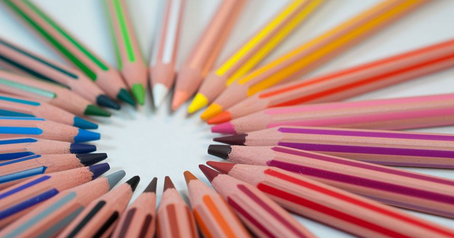 Colored pencils arranged in a circle.