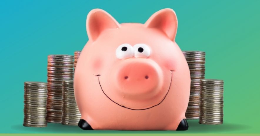smiling pink piggy bank with stacks of coins