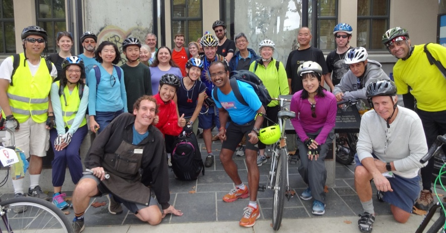 Photograph of group of bicyclists outside Mountain View Public Library