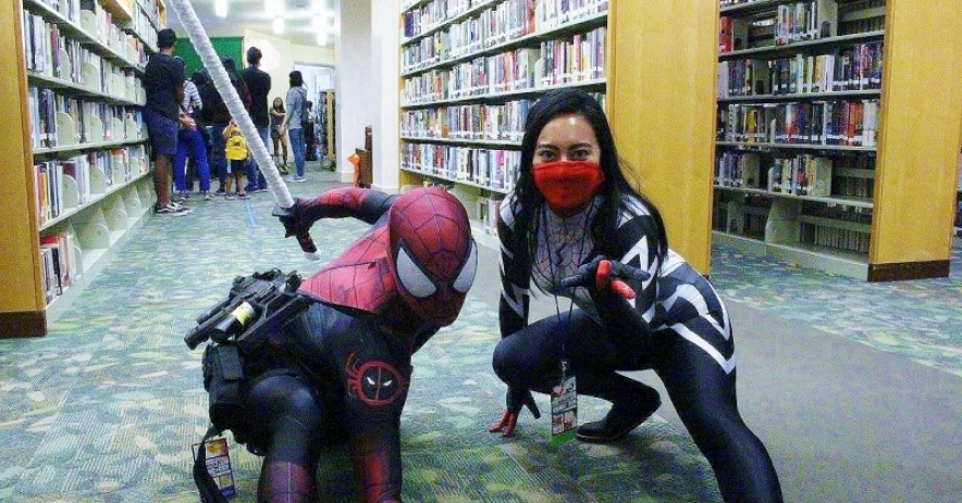 cosplayers in the library