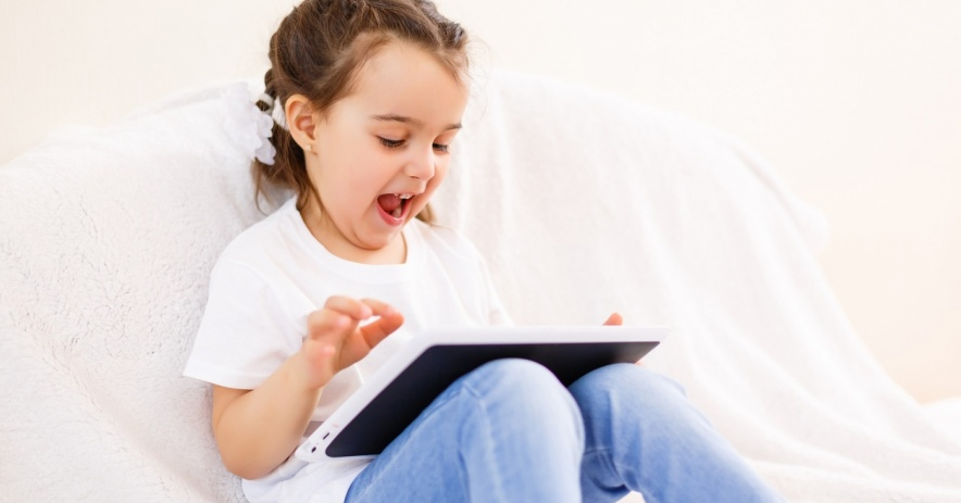 child reading on tablet