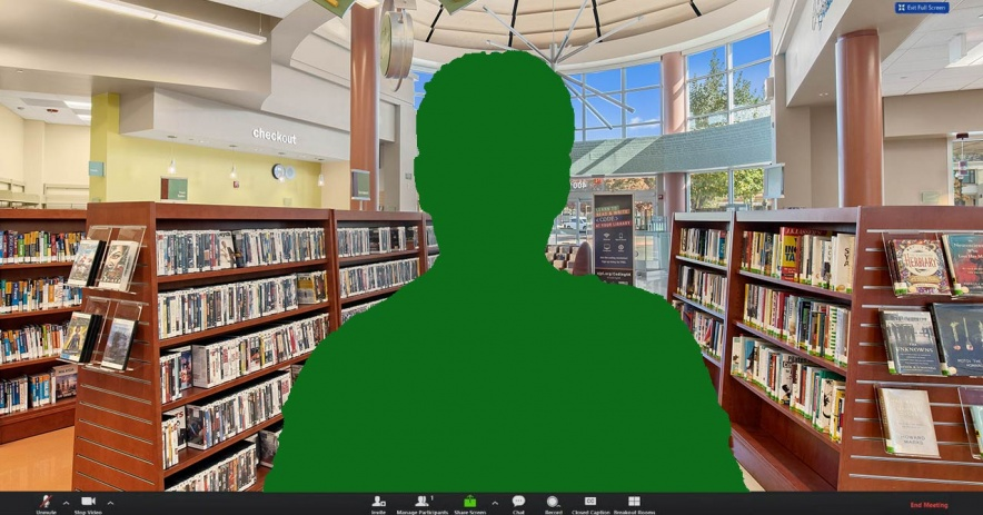 Green silhouette of a person over the interior of Village Square Branch during a Zoom teleconferencing session.