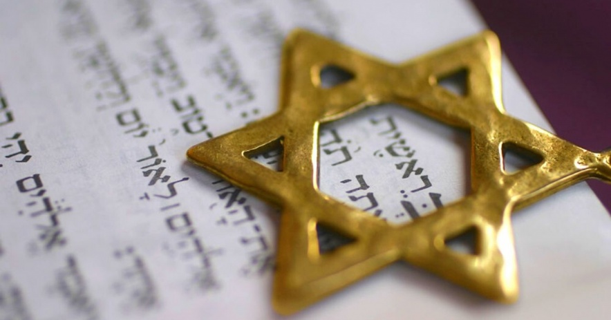 Gold Star of David on top of Hebrew text