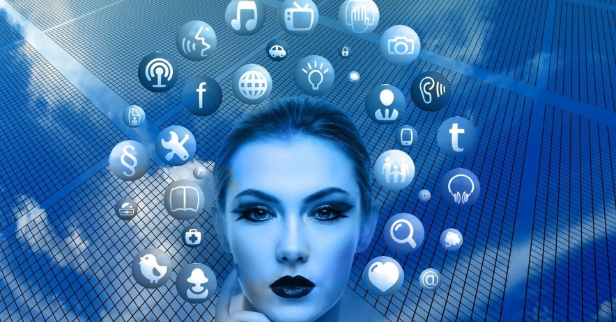 Artistic image of a woman thinking with a halo of iconic symbols of technology.