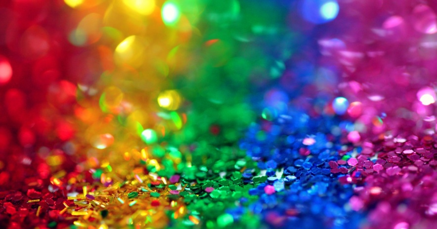 A blurry rainbow of sparkling glitter.