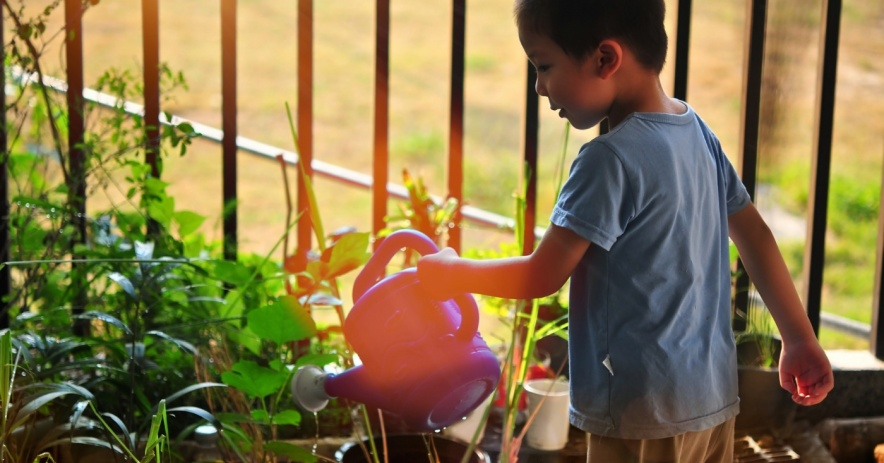 child watering can plants