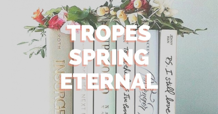 Tropes Spring Eternal sobre una pila de libros con flores encima.