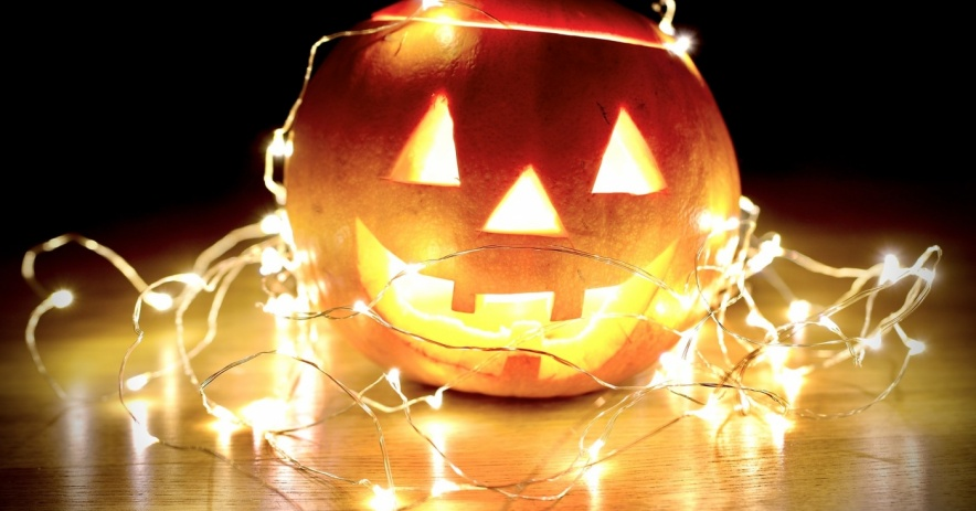 Image of a Jack O'Lantern with string lights.
