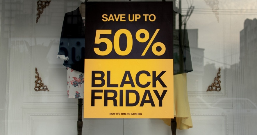 Image of Black Friday Save up to 50% off sign in a glass window display.