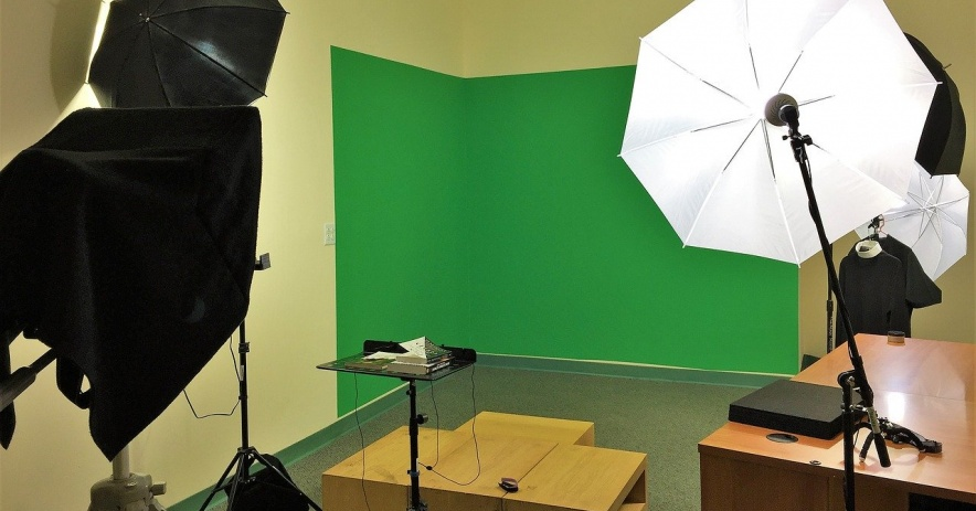 Green screen and lighting equipment for making videos.