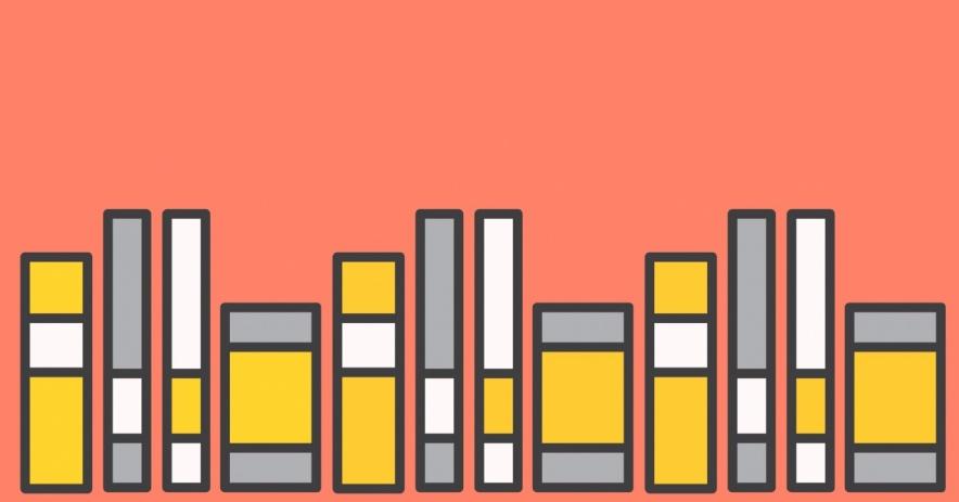 libros sobre un fondo rosa