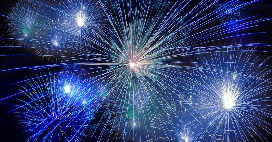 Image of a variety of blue fireworks against the night sky