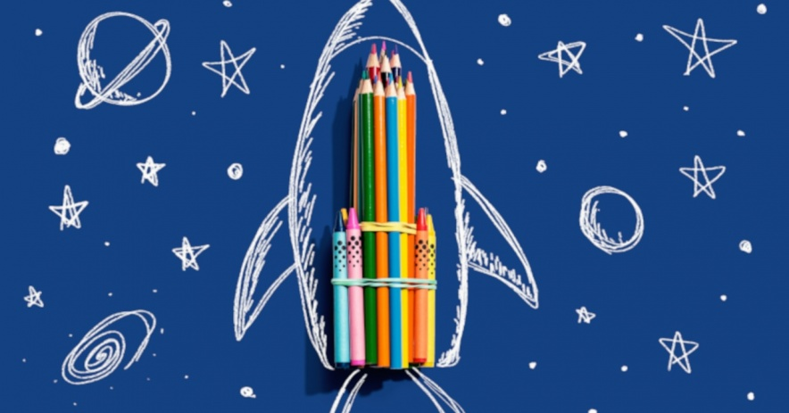 Hand drawn rocket and colored pencils.