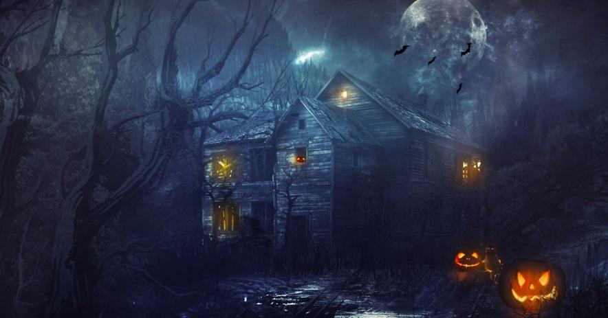 casa embrujada con calabazas en la noche