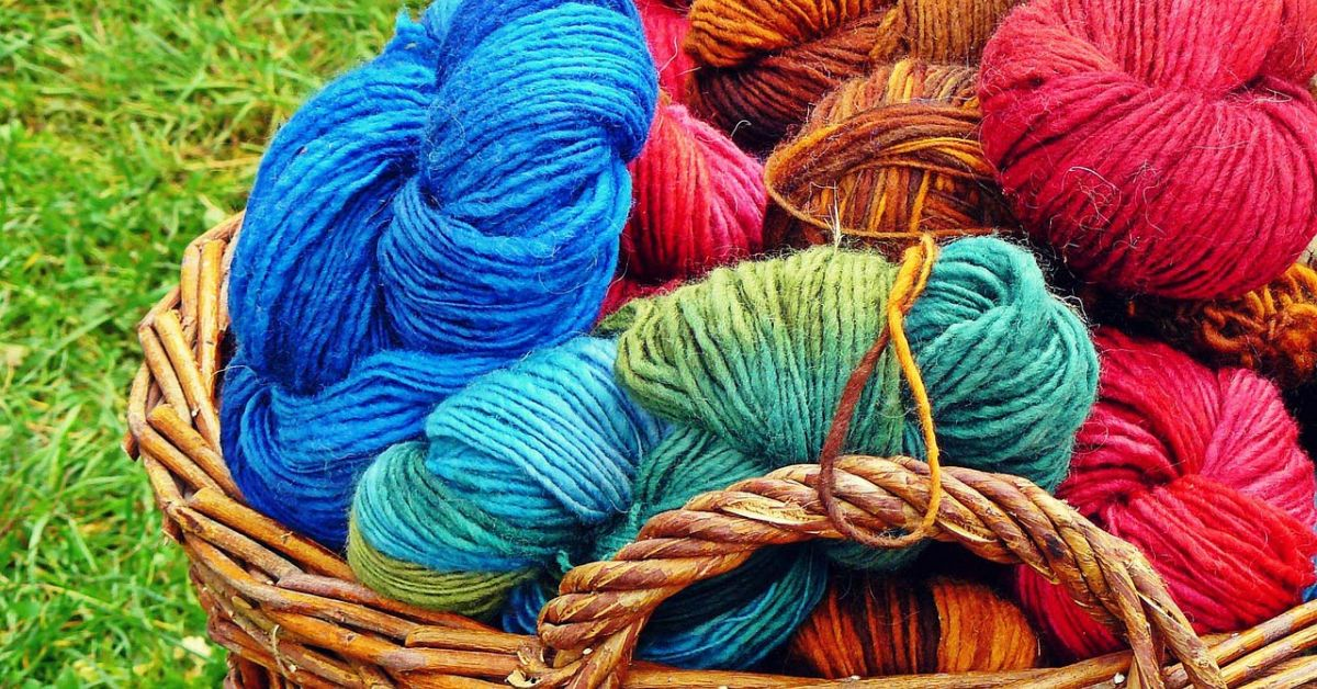 Basket of bright blue and red yarn.