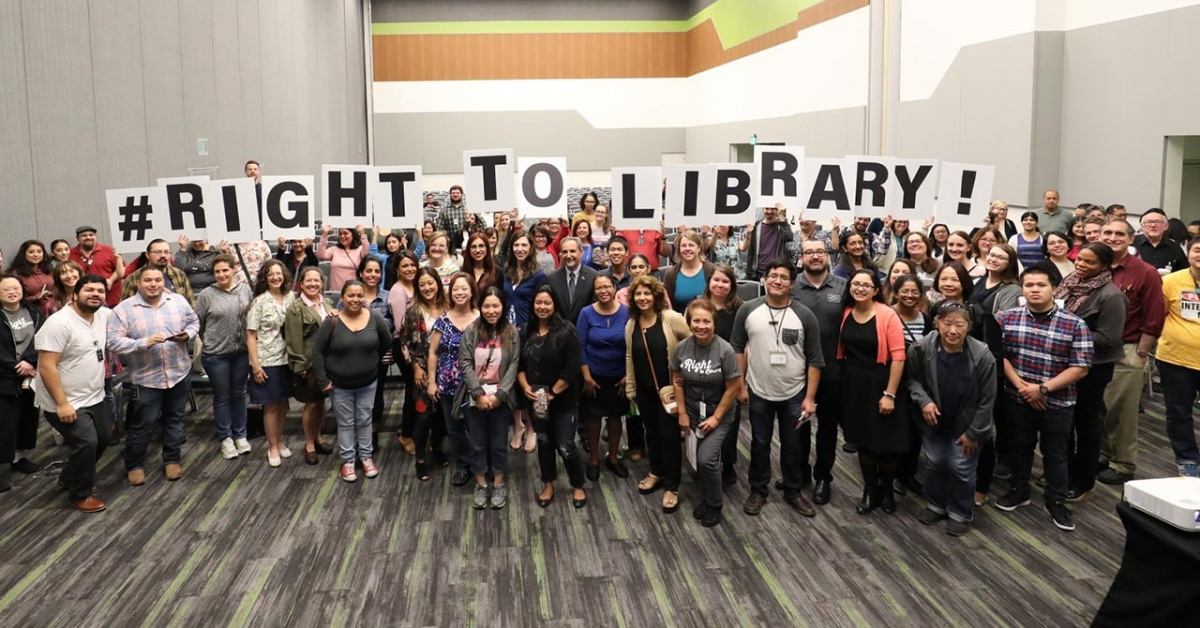 SJPL staff holding up letters that spell, #RightToLibrary