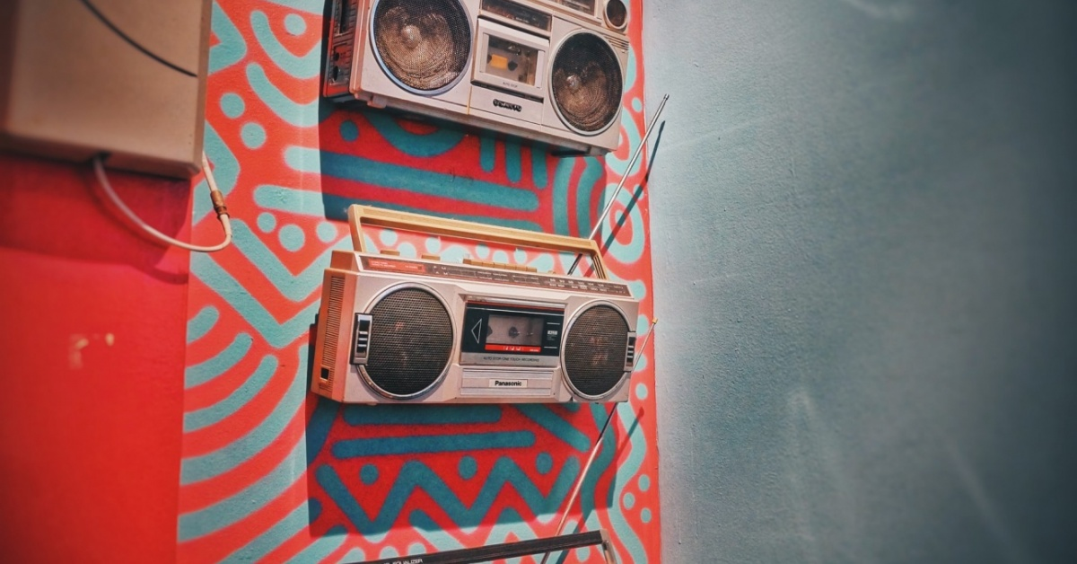Image of boomboxes on a wall.