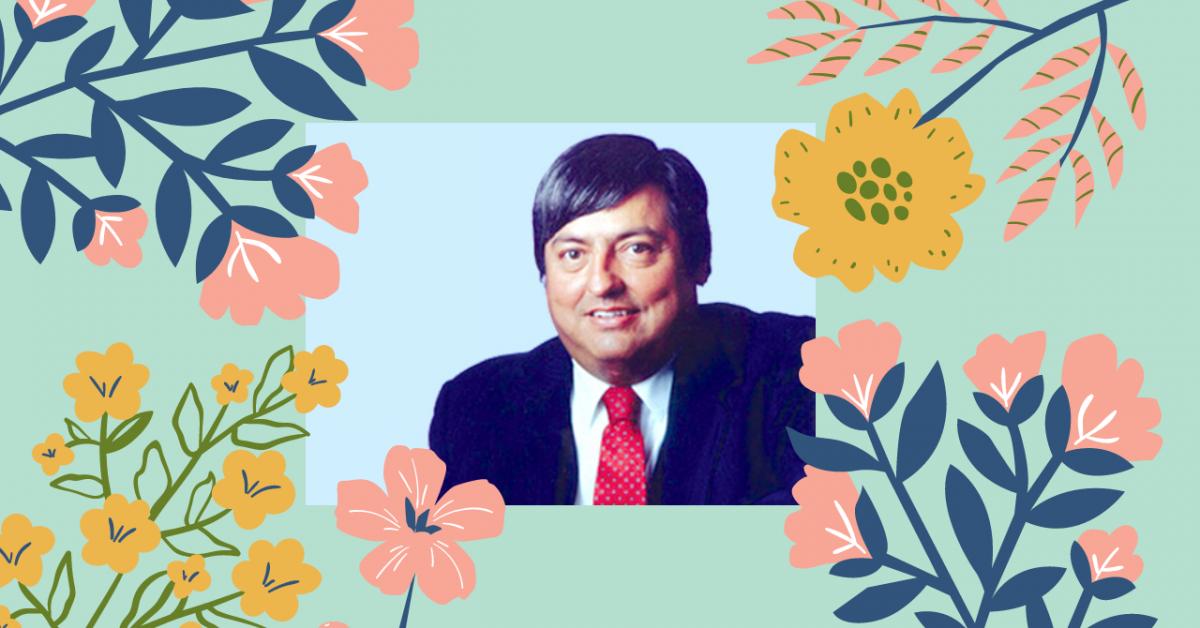 Dr. B Roberto Cruz rodeado de flores
