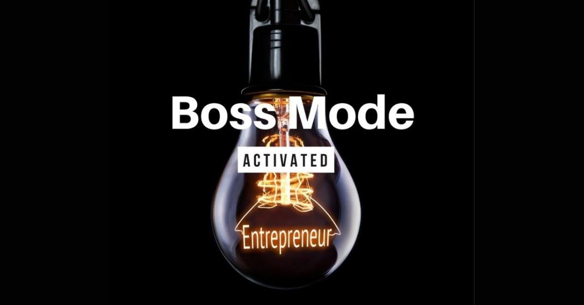 """Bombilla que dice Entreprener y las palabras """"Boss Mode Activated"""" en blanco."""