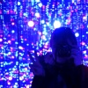 "A girl behind a camera taking a photo of her reflection in Yayoi Kusama's mirrored lights art installation, ""Gleaming Lights of the Souls""."